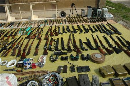 A handout photograph released by Syria's national news agency SANA on March 7, 2012, shows weapons found by Syrian security in Homs, that they said belong to armed groups. REUTERS/SANA/Handout