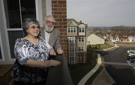 Retired couple Harvey and Cora Alter are pictured on the balcony of their planned-community apartment in Frederick, Maryland. Moving in retirement to save money - but not that far from previous homes, is a trend where retirees want to reduce the cost of living but not uproot their lives completely. Picture taken March 2, 2012. REUTERS/Jason Reed