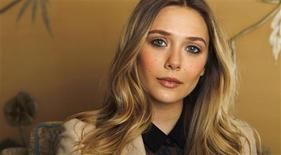 "Actress Elizabeth Olsen poses for a portrait while promoting her upcoming film ""Silent House"" in Los Angeles, California February 28, 2012. The movie opens in the U.S. on March 9. Picture taken February 28, 2012. REUTERS/Mario Anzuoni"