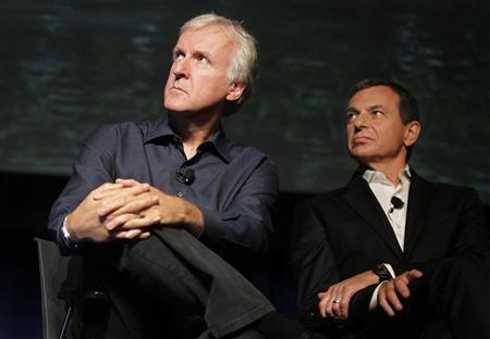 Robert A. Iger, president and CEO of The Walt Disney Co. (R) and director James Cameron attend a media briefing in Glendale, Calfornia September 20, 2011 at which they announced a long-term agreement which will bring ''Avatar'' themed lands to Disney parks with the the first at Walt Disney World in Orlando, Florida. A scene from ''Avatar'' is shown on screen background. REUTERS/Fred Prouser