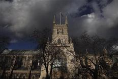 Southwark Cathedral is highlighted against dark clouds near Borough Market in London, which features in Charles Dickens' books, January 26, 2012. The month of February marks an international celebration of the life and work of Charles Dickens on the bicentenary of his birth, which falls on February 7, 2012. REUTERS/Finbarr O'Reilly