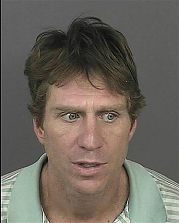 Robert Young, 43, is seen in this booking photo released to Reuters September 16, 2011. Young is one of two men accused of driving around Denver with their friend's corpse and using the dead man's debit card to pay for a night on the town including a visit to a strip club, prosecutors said on Friday. REUTERS/Denver District Attorney's Office/Handout (UNITED STATES - Tags: CRIME LAW)
