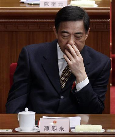 China's Chongqing Municipality Communist Party Secretary Bo Xilai reacts during the opening ceremony of the National People's Congress (NPC) at the Great Hall of the People in Beijing March 5, 2012. Bo, a senior Chinese politician whose prospects for the top leadership are under a cloud, appeared before the media on March 9, 2012 in an apparent bid to dispel rumours that a scandal involving a one-time top ally had forced him out. Picture taken March 5, 2012. REUTERS/Jason Lee
