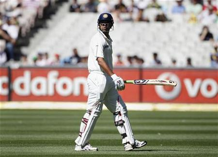 India's Rahul Dravid leaves the field after being bowled by Australia's Ben Hilfenhaus during the first cricket test match, at the Melbourne Cricket Ground December 28, 2011. REUTERS/Tim Wimborne/Files