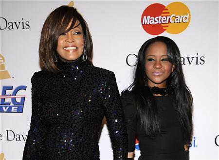Singer Whitney Houston attends the Pre-Grammy Gala & Salute to Industry Icons with Clive Davis with her daughter Bobbi Kristina Brownin Beverly Hills, California in this February 12, 2011 file photograph. Houston who died Febraury 11, 2012, has left her entire estate to her daughter Bobbi Kristina, according to Houston's will which was released March 7. REUTERS/Phil McCarten