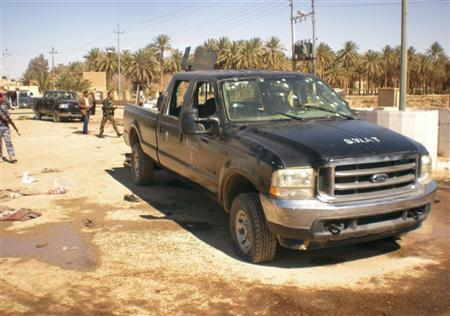 A bullet-riddled vehicle belonging to militants is seen at the site of an attack in Haditha, 190 km (120 miles) northwest of Baghdad March 5, 2012. REUTERS/Stringer