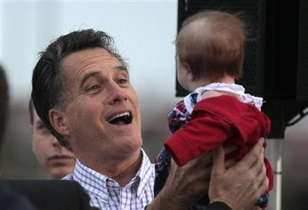U.S. Republican presidential candidate and former Massachusetts Governor Mitt Romney holds the baby of a supporter during a campaign rally at the Port of Pascagoula in Pascagoula, Mississippi, March 8, 2012. REUTERS/Dan Anderson