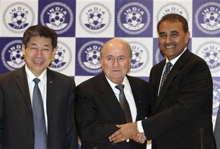 FIFA President Sepp Blatter (C) shakes hands with Praful Patel, the President of All India Football Federation as the acting president of the Asian Football Confederation (AFC), Zhang Jilong watches after a news conference in New Delhi March 9, 2012. REUTERS/B Mathur
