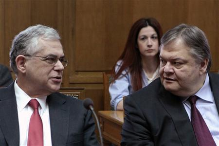 Greece's Prime Minister Lucas Papademos (L) talks with Finance Minister Evangelos Venizelos before a cabinet meeting at the parliament in Athens March 9, 2012. REUTERS/Yiorgos Karahalis