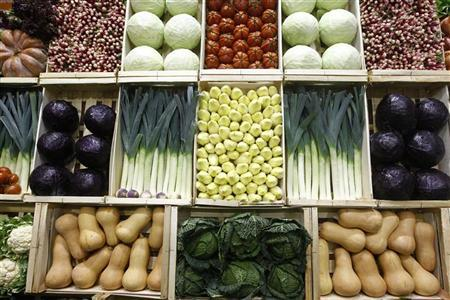 Vegetables, including cabbages, leeks, endives and squash are presented in wooden crates at the Paris Farm Show in Paris February 27, 2012. REUTERS/Jacky Naegelen