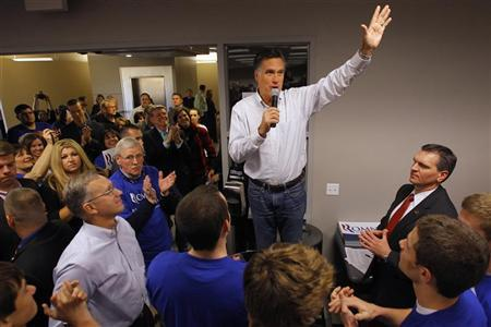 Republican presidential candidate and former Massachusetts Governor Mitt Romney stands on a chair to address campaign workers at the campaign office in Las Vegas, Nevada February 3, 2012. REUTERS/Brian Snyder