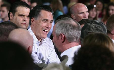 U.S. Republican presidential candidate Mitt Romney speaks with workers and supporters at Thompson Tractor in Birmingham, Alabama March 9, 2012. REUTERS/Marvin Gentry