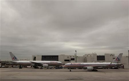 American Airlines planes taxi past a terminal at Miami International airport in Miami, Florida November 29, 2011. REUTERS/Lucas Jackson
