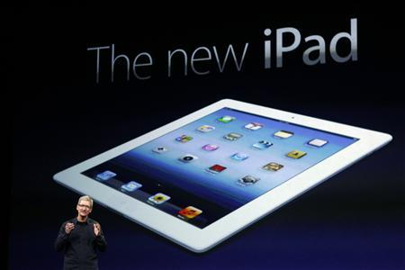 Apple CEO Tim Cook speaks during an Apple event as he introduces the new iPad as an image the device is projected on screen in San Francisco, California March 7, 2012. REUTERS/Robert Galbraith