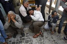 Palestinians react at a hospital following an Israeli air strike in Khan Younis in the southern Gaza Strip March 10, 2012. REUTERS/Ibraheem Abu Mustafa