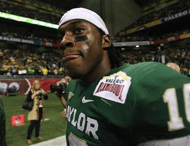 Heisman Trophy winner Robert Griffin III of Baylor University walks off the field after their NCAA football game against the Washington Huskies at the Valero Alamo Bowl in San Antonio, Texas, December 29, 2011. REUTERS/Joe Mitchell