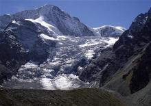 A general view shows the Pigne D'Arolla mountain in the Swiss Alps, near Zermatt, September 7, 2007. Switzerland has been particularly hard hit by a warming climate, with ski resorts often short of snow cover and potential water supply problems as sources melt away. To match WITNESS-SWISS/WARMING REUTERS/Sam Cage