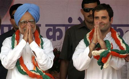 India's Prime Minister Manmohan Singh (L) and Rahul Gandhi, a lawmaker and the son of India's ruling Congress party chief Sonia Gandhi, gesture during a public meeting in the Bundelkhand region of the northern Indian state of Uttar Pradesh April 30, 2011. REUTERS/Pawan Kumar