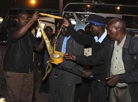 Kenyan policemen secure the blast area after four explosions in Kenya's capital Nairobi March 10, 2012. REUTERS/Noor Khamis