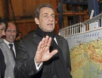 Nicolas Sarkozy, France's President and UMP party candidate for the 2012 French presidential elections, gestures as he visits a small firm, as part of his electoral campaign in Nice, southern France, March 9, 2012. REUTERS/Claude Paris/Pool