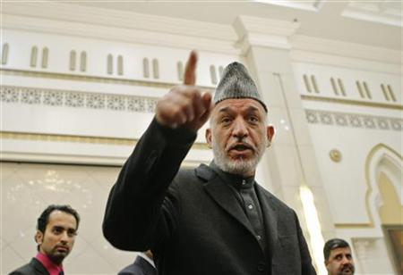 Afghan President Hamid Karzai speaks during a news conference in Kabul February 26, 2012. REUTERS/Mohammad Ismail