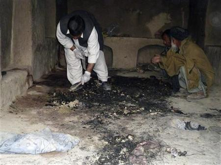 Afghan men investigate at the site of an shooting incident in Kandahar province, March 11, 2012. REUTERS/Ahmad Nadeem