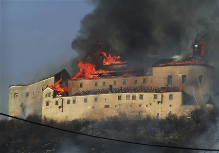 The Krasna Horka castle is seen on fire in the village of Krasnohorske Podhradie near Roznava, eastern Slovakia March 10, 2012. REUTERS/Stringer