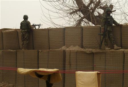 Afghan National Army soldiers keep watch inside a U.S. base in Panjwai district Kandahar province, March 11, 2012. REUTERS/Ahmad Nadeem