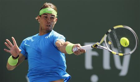 Rafael Nadal of Spain returns a shot against Leonardo Mayer of Argentina during their match at the Indian Wells ATP tennis tournament in Indian Wells, California, March 11, 2012. REUTERS/Danny Moloshok