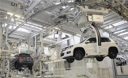 VW Tiguan cars are pictured in a production line at the plant of German carmaker Volkswagen in Wolfsburg, March 7, 2012. REUTERS/Fabian Bimmer
