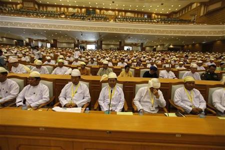 Members of parliament attend a meeting before Myanmar's President Thein Sein delivers a speech at the Union Parliament in Naypyitaw March 1, 2012. REUTERS/Soe Zeya Tun