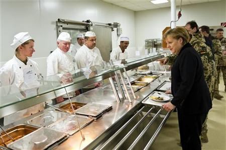 German Chancellor Angela Merkel visits the Dining Facility in the German army's Camp Marmal in Mazar-e-Sharif, March 12, 2012. REUTERS/Bundesregierung/Steffen Kugler