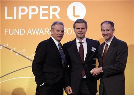 Roddy Cummins VP & CIO (R) and John Jones, President of GuideStone Funds (L) stand with Lars Asplund, Managing Director of Lipper, as they are presented the award for Best Overall Small Firm at the Thomson Reuters Lipper Awards ceremony, in New York, March 8, 2012. REUTERS/Chip East