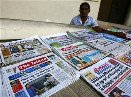 A women sells newspapers discussing the parliamentary elections a day after Sri Lanka voted for a new parliament in Colombo April 9 , 2010. REUTERS/Andrew Caballero-Reynolds