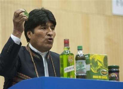 Bolivia's President Evo Morales holds a coca leaf as he speaks and shows other products made with a coca leaves as he speaks during the 55th session of the Commission on Narcotic Drugs at the United Nations' headquarters in Vienna in this March 12, 2012 handout photo. REUTERS/Bolivian Presidency/Handout
