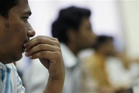A broker reacts while trading at a stock brokerage firm in Mumbai February 6, 2008. REUTERS/Arko Datta/Files
