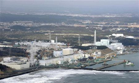 Tokyo Electric Power Co. (TEPCO)'s tsunami-crippled Fukushima Daiichi nuclear power plant is seen in Fukushima prefecture, in this aerial view photo taken by Kyodo March 11, 2012. REUTERS/Kyodo