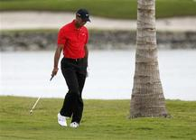 Tiger Woods of the U.S. walks down the fairway on the 10th hole during fourth round play in the WGC-Cadillac Championship PGA golf tournament at the Doral Golf Resort in Doral, Florida, March 11, 2012