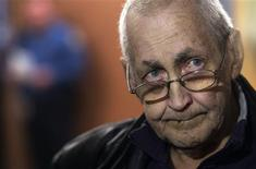 Lung-cancer victim Jean-Yves Blais waits for the start of his class-action lawsuit against Canada's three main tobacco companies in Montreal, March 12, 2012. Two-major class-actions worth C$27 billion began on Monday, the first class action against tobacco companies in Canada to come to trial stage. REUTERS/Christinne Muschi