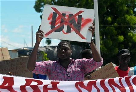 Demonstrators carrying signs march in Port-au-Prince September 23, 2011, as Haitian President Michel Martelly is scheduled to speak to the United Nations General Assembly in New York. Demonstrators accuse the United Nations Stabilisation Mission In Haiti (UNSTAMIH), also known as MINUSTAH, for bringing cholera into their country, for the rape and murder of their people and demand for their immediate withdrawal. REUTERS/Swoan Parker