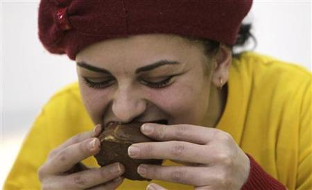 A woman takes part in a chocolate eating competition in Tbilisi February 10, 2012. REUTERS/David Mdzinarishvili