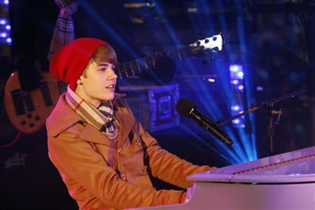 Justin Bieber performs during New Year's Eve celebrations in Times Square in New York, December 31, 2011. REUTERS/Eduardo Munoz
