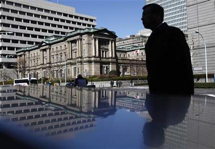 A man walks in front of the Bank of Japan headquarters building in Tokyo March 13, 2012. The Bank of Japan kept monetary policy steady after last month's surprise easing but extended a loan scheme for growth sectors to keep up its long-term efforts to boost the country's potential growth and beat deflation. REUTERS/Yuriko Nakao