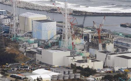 Tokyo Electric Power Co. (TEPCO)'s tsunami-crippled Fukushima Daiichi nuclear power plant's reactor buildings one to four (L to R) are seen in Fukushima prefecture, in this aerial view photo taken by Kyodo, March 11, 2012, the day marking the first anniversary of the earthquake and tsunami that killed thousands and set off a nuclear crisis. REUTERS/Kyodo