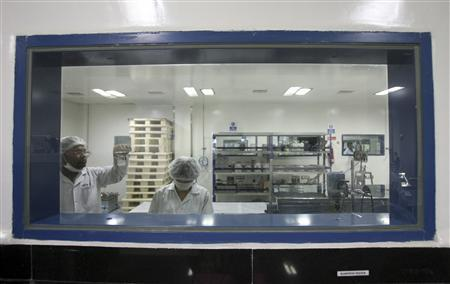 Pharmacologists work inside Natco Research Centre in the southern Indian city of Hyderabad March 13, 2012. REUTERS-Krishnendu Halder
