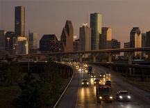 Traffic flows at dusk with the downtown Houston skyline in the background as night falls on America's fastest growing large city October 3, 2008. REUTERS/Richard Carson