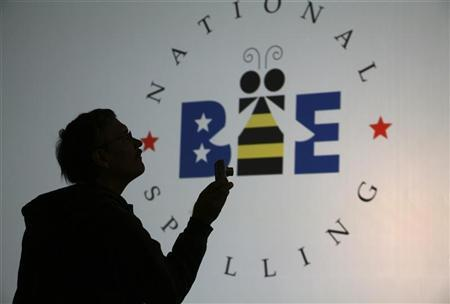 A spectator takes photos of contestants on stage before the start of the second phase of round three of the 2011 Scripps National Spelling Bee at the Gaylord National Resort and Convention Center at National Harbor, Maryland, June 1, 2011. REUTERS/Molly Riley