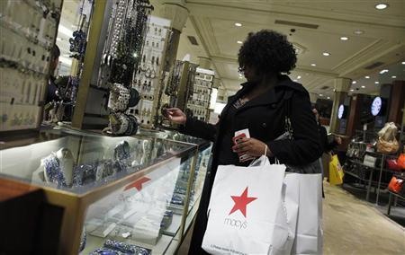 A shopper looks at jewelry inside Macy's Manhattan department store in New York January 12, 2012. REUTERS/Eduardo Munoz