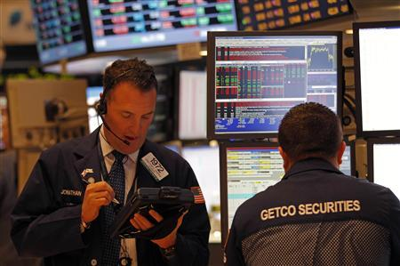 Traders work just after the opening bell on the floor of the New York Stock Exchange March 12, 2012. REUTERS/Adam Hunger