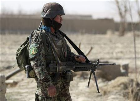 An Afghan National Army soldier keeps watch near a mosque where an Afghan delegation meets with locals in Alokozai village, Panjwai district Kandahar province, March 13, 2012. REUTERS/ Ahmad Nadeem